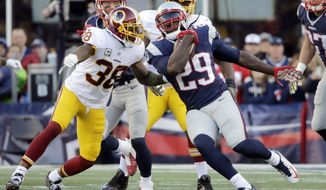 Washington Redskins safety Dashon Goldson (38) pursues New England Patriots running back LeGarrette Blount (29) during the second half of an NFL football game, Sunday, Nov. 8, 2015, in Foxborough, Mass. (AP Photo/Steven Senne)