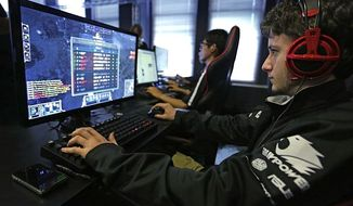 Video gamers are now an important voting bloc, according to a new poll. (AP Photo)