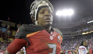 Tampa Bay Buccaneers quarterback Jameis Winston (3) leaves the field following the team's 32-18 loss to the New York Giants during an NFL football game Sunday, Nov. 8, 2015, in Tampa, Fla. (AP Photo/Phelan M. Ebenhack)