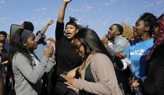 Students celebrate following University of Missouri System President Tim Wolfe's resignation announcement Monday, Nov. 9, 2015, at the school in Columbia, Mo. The president resigned Monday with the football team and others on campus in open revolt over his handling of racial tensions at the school. (AP Photo/Jeff Roberson)