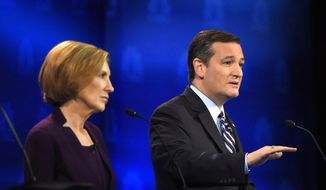 FILE - In this Oct. 28, 2015 file photo, Republican presidential candidates, Sen.Ted Cruz, R-Texas, accompanied by Carly Fiorina, speaks during Republican presidential debate at the University of Colorado, Wednesday in Boulder, Colo. (AP Photo/Mark J. Terrill, File)