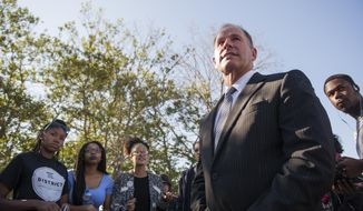 In a Tuesday, Nov. 3, 2015 photo, University of Missouri President Tim Wolfe speaks with members of Concerned Student 1950 senior Abigail Hollis, from left, senior DeShaunya Ware and junior Shelbey Parnell as they call for Wolfe's resignation outside University Hall on the University of Missouri campus, in Columbia, Mo. Wolfe resigned Monday, Nov. 9, 2015, amid criticism of handling of racial issues.  (Daniel Brenner/Columbia Daily Tribune via AP)