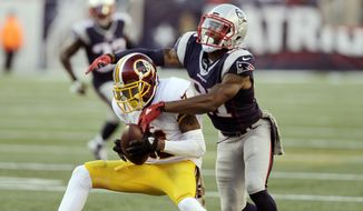 Washington Redskins wide receiver DeSean Jackson (11) catches a pass in front of New England Patriots safety Malcolm Butler (21)  during the second half of an NFL football game, Sunday, Nov. 8, 2015, in Foxborough, Mass. (AP Photo/Charles Krupa)