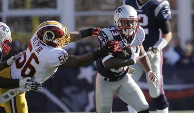 New England Patriots running back Dion Lewis (33) runs from Washington Redskins linebacker Perry Riley (56) during the first half of an NFL football game, Sunday, Nov. 8, 2015, in Foxborough, Mass. (AP Photo/Steven Senne)