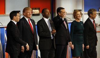 Republican presidential candidates John Kasich, Jeb Bush, Marco Rubio, Donald Trump, Ben Carson, Ted Cruz, Carly Fiorina and Rand Paul take the stage during Republican presidential debate at Milwaukee Theatre, Tuesday, Nov. 10, 2015, in Milwaukee. (AP Photo/Morry Gash)