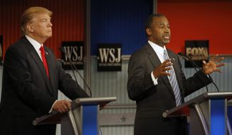 Ben Carson, right, speaks as Donald Trump listens during Republican presidential debate at Milwaukee Theatre, Tuesday, Nov. 10, 2015, in Milwaukee. (AP Photo/Morry Gash)