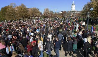 Members of Concerned Student 1950, University of Missouri's Graduate Professional Council, faculty and student supporters gather at Mel Carnahan Quadrangle to rally in support of an ongoing protest to get UM System President Tim Wolfe to resign on Monday, Nov. 9, 2015. (Matt Hellman/Missourian via AP) ** FILE **