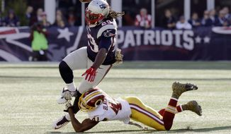 Washington Redskins cornerback Will Blackmon (41) tackles New England Patriots running back LeGarrette Blount (29) during the first half of an NFL football game, Sunday, Nov. 8, 2015, in Foxborough, Mass. (AP Photo/Charles Krupa)