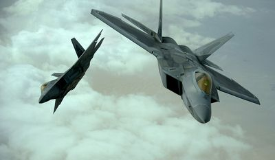 U.S. Air Force F-22 Raptors fly in formation during a training mission, Dec. 6, 2009.  The F-22 fighters and crews are deployed from the 27th Fighter Squadron at Langley Air Force Base, Va., and in the Air Forces Central area of responsibility for the first time as part of a multinational exercise where aircrews from France, Jordan, Pakistan, the U.A.E., the U.K., and the U.S. trained together in fighting a large-scale air war.  (U.S. Air Force photo by Staff Sgt. Michael B. Keller)
