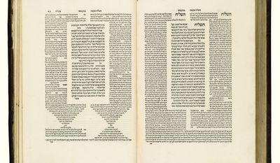 This undated photo provided by Sotheby's in New York shows the first ever printing of the Talmud in Venice in the 1520s. It will be auctioned by Sotheby's in New York on Dec. 22, 2015. It is part of what experts consider the world's most important private library of Hebrew books and manuscripts, collected by a London diamond dealer. (Sotheby's via AP)