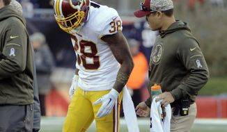 Washington Redskins safety Dashon Goldson (38) leaves the field after an injury during the second half of an NFL football game against the New England Patriots, Sunday, Nov. 8, 2015, in Foxborough, Mass. (AP Photo/Steven Senne)