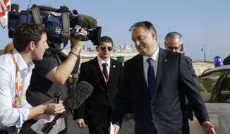 Hungarian Prime Minister Viktor Orban arrives on the occasion of a summit on migration in Valletta, Malta, Thursday, Nov. 12, 2015. (AP Photo/Antonio Calanni)