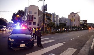 Police block off Cesar Chavez near St. Luke's hospital where a shooting occurred in San Francisco, on Wednesday, Nov. 11, 2015. San Francisco's police chief says officers have shot and killed a man who was pointing a rifle at a hospital from atop an adjacent construction site. (Connor Radnovich/San Francisco Chronicle via AP)