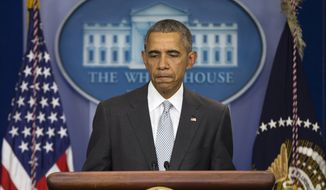 """President Barack Obama pauses as he speaks about attacks in Paris from the briefing room of the White House, on Friday, Nov. 13, 2015, in Washington. Obama is calling the attacks on Paris an """"outrageous attempt to terrorize innocent civilians"""" and vows to do whatever it takes to help bring the perpetrators to justice. (AP Photo/Evan Vucci)"""