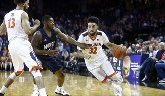 Virginia guard London Perrantes (32) drives during the first half of an NCAA college basketball game in Charlottesville, Va., on Friday, Nov. 13, 2015. Virginia won 86-48. (AP Photo/Ryan M. Kelly)