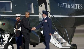 President Barack Obama shakes hands with Col. John C. Millard as he walks from Marine One to board Air Force One, Saturday, Nov. 14, 2015, in Andrews Air Force Base, Md. The president is departing for a nine-day trip to Turkey, the Philippines and Malaysia for global security and economic summits. The global anxiety sparked by a series of deadly attacks in Paris by the Islamic State group has given new urgency to Obama's upcoming talks with world leaders. (AP Photo/Carolyn Kaster)