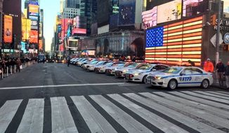 Anti-terror police officers in New York City's Times Square. (Image: Twitter/@JPeterDonald, @NYPDNews)