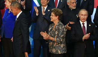 "U.S. President Barack Obama, left, Japanese Prime Minister Shinzo Abe, Brazilian President Dilma Rousseff, Indian Prime Minister Narendra Modi and Russian†President Vladimir Putin leave after posing for a group photo at the G-20 summit in Antalya, Turkey, Sunday, Nov. 15, 2015. President Barack Obama pledged Sunday to redouble U.S. efforts to eliminate the Islamic State group and end the Syrian civil war that has fueled its rise, denouncing the extremist group's horrifying terror spree in Paris as ""an attack on the civilized world."" (AP Photo/Lefteris Pitarakis)"