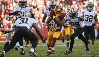 Washington Redskins wide receiver Jamison Crowder (80) carries the ball during the first half of an NFL football game against the New Orleans Saints in Landover, Md., Sunday, Nov. 15, 2015. (AP Photo/Evan Vucci)