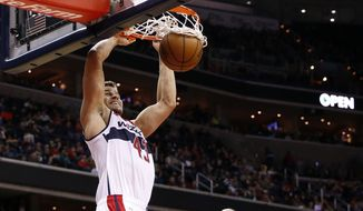 Washington Wizards forward Kris Humphries (43) dunks the ball in front of Orlando Magic forward Channing Frye (8) in the second half of an NBA basketball game, Saturday, Nov. 14, 2015, in Washington. Humphries had 23 points. The Wizards won 108-99. (AP Photo/Alex Brandon)