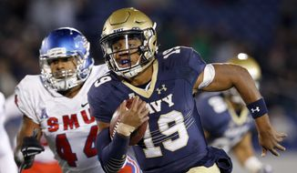 Navy quarterback Keenan Reynolds (19) rushes the ball for a touchdown past SMU linebacker Jackson Mitchell in the second half of an NCAA college football game Saturday, Nov. 14, 2015, in Annapolis, Md. Navy won 55-14. (AP Photo/Patrick Semansky)