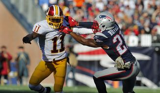 Washington Redskins wide receiver DeSean Jackson tries to break free from New England Patriots cornerback Malcolm Butler (21) during a NFL football game at Gillette Stadium in Foxborough, Mass. Sunday Nov. 8, 2015. (Winslow Townson/AP Images for Panini)