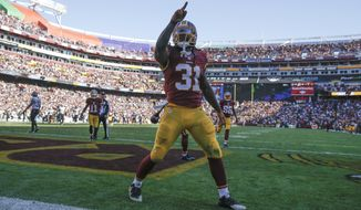 Washington Redskins running back Matt Jones (31) celebrates his 78 yard touchdown during the first half of an NFL football game against the New Orleans Saints in Landover, Md., Sunday, Nov. 15, 2015. (AP Photo/Evan Vucci)