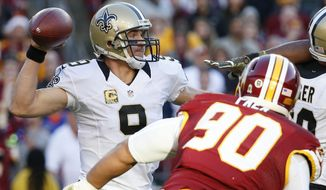 New Orleans Saints quarterback Drew Brees (9) passes the ball during the second half of an NFL football game against the Washington Redskins in Landover, Md., Sunday, Nov. 15, 2015. (AP Photo/Alex Brandon)