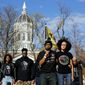 Jonathan Butler, front left, addresses a crowd following the announcement that University of Missouri System President Tim Wolfe would resign Monday, Nov. 9, 2015, at the university in Columbia, Mo. Butler has ended his hunger strike as a result of the resignation. Associated Press Photo