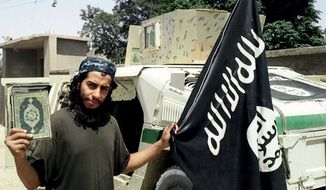 This undated image made available in the Islamic State's English-language magazine Dabiq, shows Abdelhamid Abaaoud, who grew up in the Molenbeek-Saint-Jean neighborhood of Belgian capital. Abaaoud  was identified by French authorities on Monday as the presumed mastermind of the terror attacks Friday in Paris.
