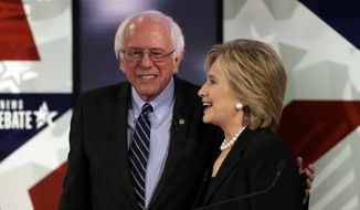 Hillary Rodham Clinton, right, talks to Bernie Sanders after a Democratic presidential primary debate, Saturday, Nov. 14, 2015, in Des Moines, Iowa. (AP Photo/Charlie Neibergall) ** FILE **
