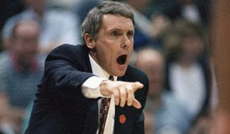Maryland coach Gary Williams encourages his team during the opening minutes of their NCAA Midwest Regional semifinal game against Michigan, March 25, 1994, in Dallas. (AP Photo/Eric Gay)