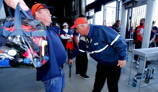 Fans pass through security at Mile High Stadium prior to an NFL football game between the Kansas City Chiefs and the Denver Broncos, Sunday, Nov. 15, 2015, in Denver. (AP Photo/Jack Dempsey) ** FILE **