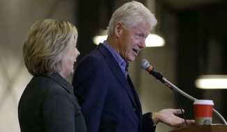 Democratic presidential candidate Hillary Rodham Clinton listens to her husband, former President Bill Clinton, speak at the Central Iowa Democrats Fall Barbecue Sunday, Nov. 15, 2015, in Ames, Iowa. (Associated Press)