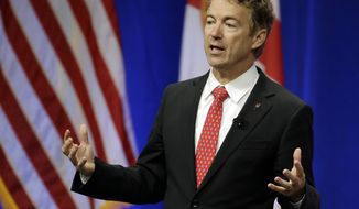 Republican presidential candidate Sen. Rand Paul, R-Ky., addresses the Sunshine Summit in Orlando, Fla., Saturday, Nov. 14, 2015. (AP Photo/John Raoux)