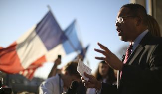Congressman Keith Ellison addresses the marchers from the steps of the Basilica in Minneapolis, Sunday, Nov. 15, 2015, during a march to show solidarity with France after the deadly attacks in Paris on Friday. (Jeff Wheeler/Star Tribune via AP)  MANDATORY CREDIT; ST. PAUL PIONEER PRESS OUT; MAGS OUT; TWIN CITIES LOCAL TELEVISION OUT