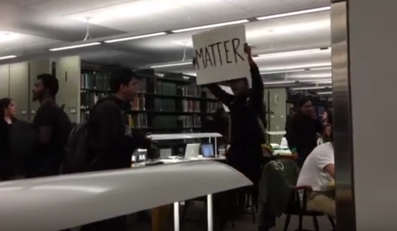 Roughly 150 Black Lives Matter protesters stormed a library at Dartmouth College in Hanover, New Hampshire, Thursday night to berate students studying there for their supposed racial privilege. (YouTube/@CampusReform)