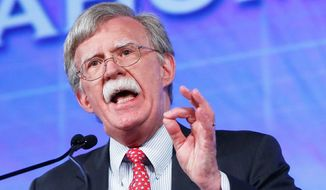 John R. Bolton has determined five fundamental questions for voters to ask presidential candidates who aspire to lead the nation in a dangerous world. (Associated Press)
