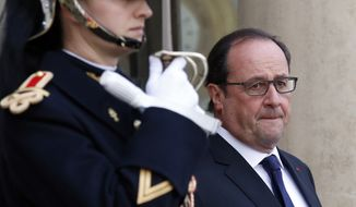 French President Francois Hollande waits for the arrival of US Secretary of State John Kerry at the Elysee Palace, in Paris, France, Tuesday, Nov. 17, 2015. Kerry arrived in Paris to pay tribute to last Friday November 13 attacks in France. (AP Photo/Francois Mori)