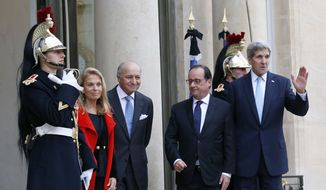 U.S. Secretary of State John Kerry, right, poses with French President Francois Hollande, second right, and U.S. Ambassador to France Jane D. Hartley, left, with French Foreign Laurent Fabius upon arrival at the Elysee Palace, in Paris, France, Tuesday, Nov. 17, 2015. Kerry arrived in Paris to pay tribute to last Friday November 13 attacks in France. (AP Photo/Francois Mori)