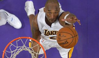 Los Angeles Lakers forward Kobe Bryant grabs a rebound during the second half of an NBA basketball game against the Detroit Pistons, Sunday, Nov. 15, 2015, in Los Angeles. (Associated Press)