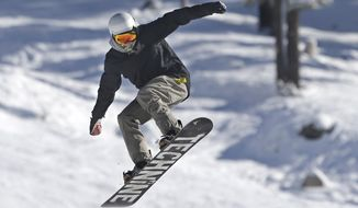 In this Nov. 10, 2015 photo, a snowboarder goes over a jump at the Boreal Mountain Resort near Donner Summit, Calif. With a number of California ski resorts open already, forecasters are hoping that a strong El Nino winter will bring above-average precipitation to California this season after several years of dismal snowfall. (AP Photo/Rich Pedroncelli, File)