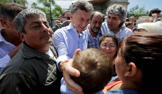 Front-runner: An Argentine presidential win for Mauricio Macri would mark the first major electoral defeat for leftist governments dominating South America. (Associated Press)