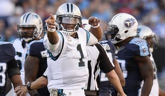 Carolina Panthers quarterback Cam Newton (1) celebrates a first down against the Tennessee Titans in the second half of an NFL football game Sunday, Nov. 15, 2015, in Nashville, Tenn. (AP Photo/Mark Zaleski)