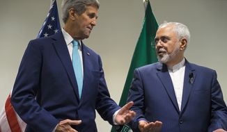 Secretary of State John Kerry (left) meets with Iranian Foreign Minister Mohammad Javad Zarif at United Nations headquarters on Sept. 26, 2015. (Associated Press) **FILE**