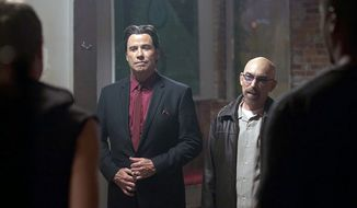 "Jackie Earle Haley (right) directs and co-stars in ""Criminal Activities"" with John Travolta.  (sacurrent.com)"