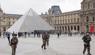 Soldiers patrol in the courtyard of the Louvre museum in Paris. The Belgian extremist suspected of masterminding the deadly attacks in Paris was killed Wednesday but intelligence officials are alarmed that he was able to slip so easily back and forth between Syria and the heart of Western Europe. (Associated Press photographs)