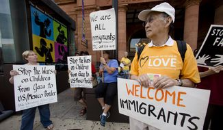 FILE - This July 18, 2014, file photo shows protestors in Philadelphia demonstrating near the Consulate of Mexico in support of immigrants recently entering the United States via Mexico. For Republican Rep. Scott Perry of Pennsylvania the influx of Central American children who have crossed illegally into the United States has propelled immigration to a top concern for voters in his heavily rural district far from the Mexican border, eclipsing the new health care law and the federal deficit. (AP Photo/Matt Rourke, File)