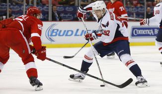 Washington Capitals center Evgeny Kuznetsov (92) skates with the puck against the Detroit Red Wings in the third period of an NHL hockey game Wednesday, Nov. 18, 2015 in Detroit. (AP Photo/Paul Sancya)