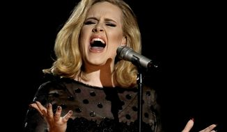 "FILE - In this Feb. 12, 2012 file photo, Adele performs during the 54th annual Grammy Awards in Los Angeles. The singer's hotly anticipated new album, ""25,"" is out Friday, Nov. 20, 2015. (AP Photo/Matt Sayles, File)"